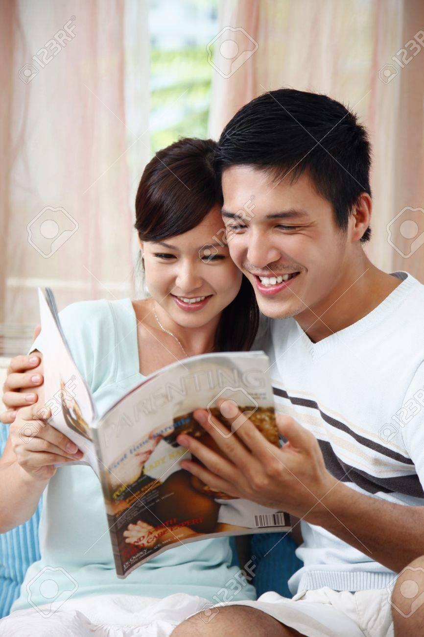 Man and woman reading magazine Stock Photo - 8606061