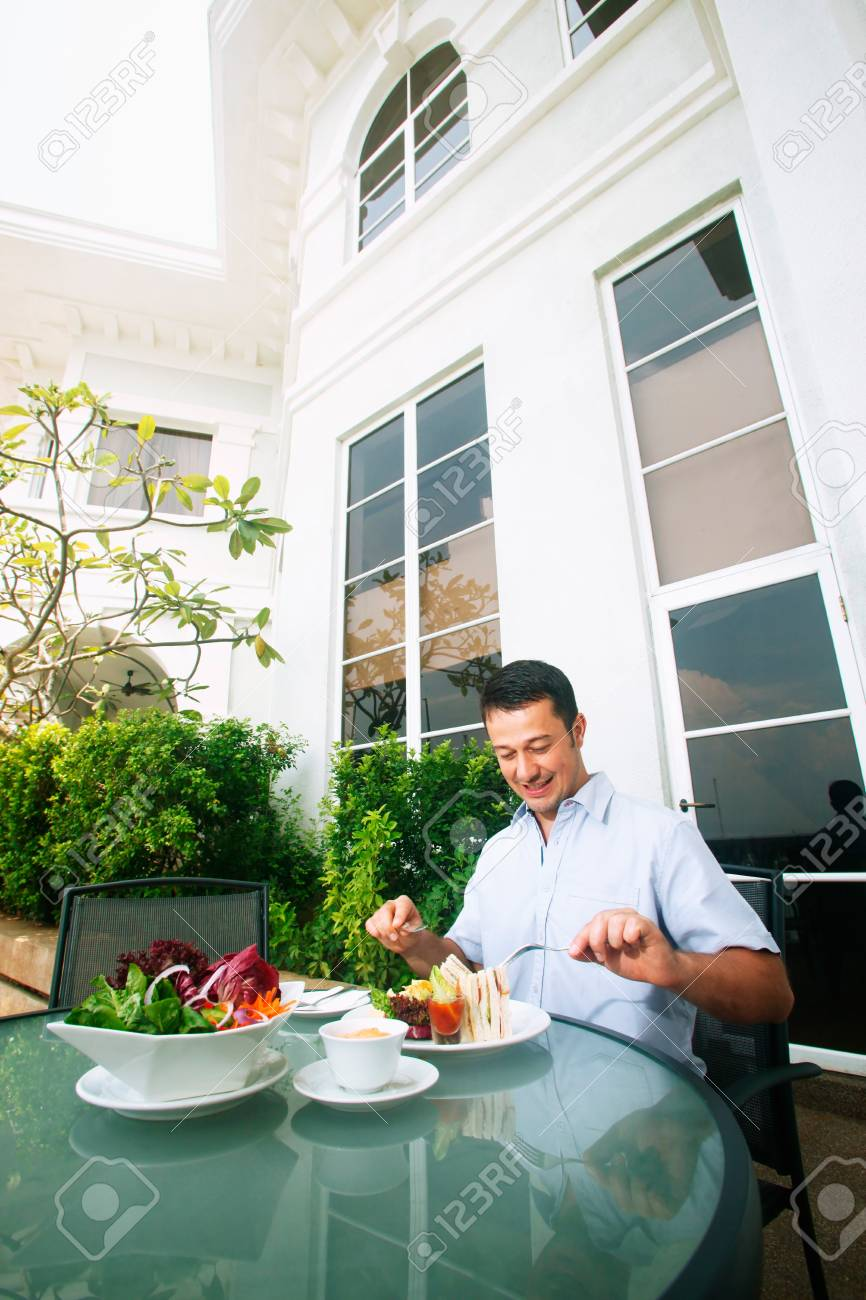 Man having a meal at an outdoor restaurant Stock Photo - 9041750