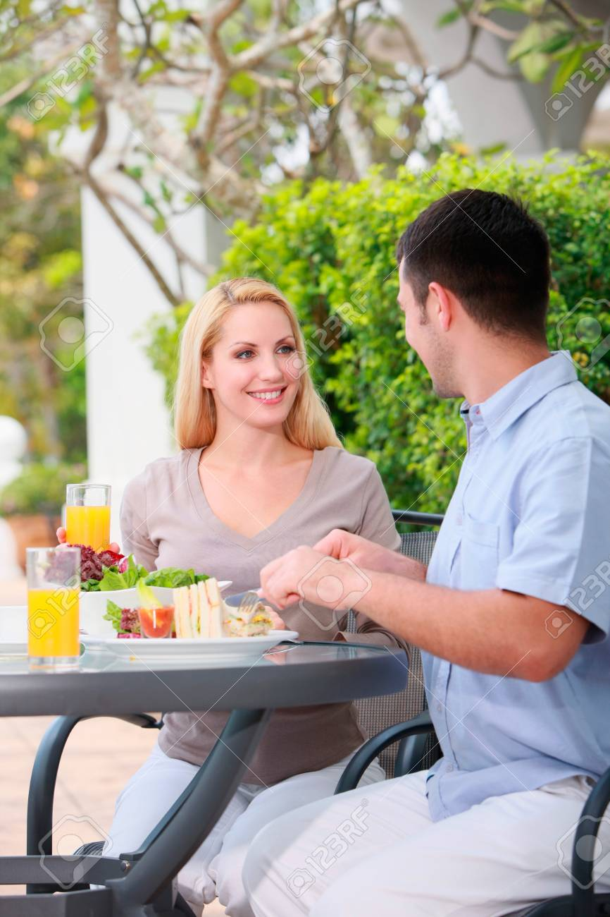 Man and woman having a meal at an outdoor restaurant Stock Photo - 9043190