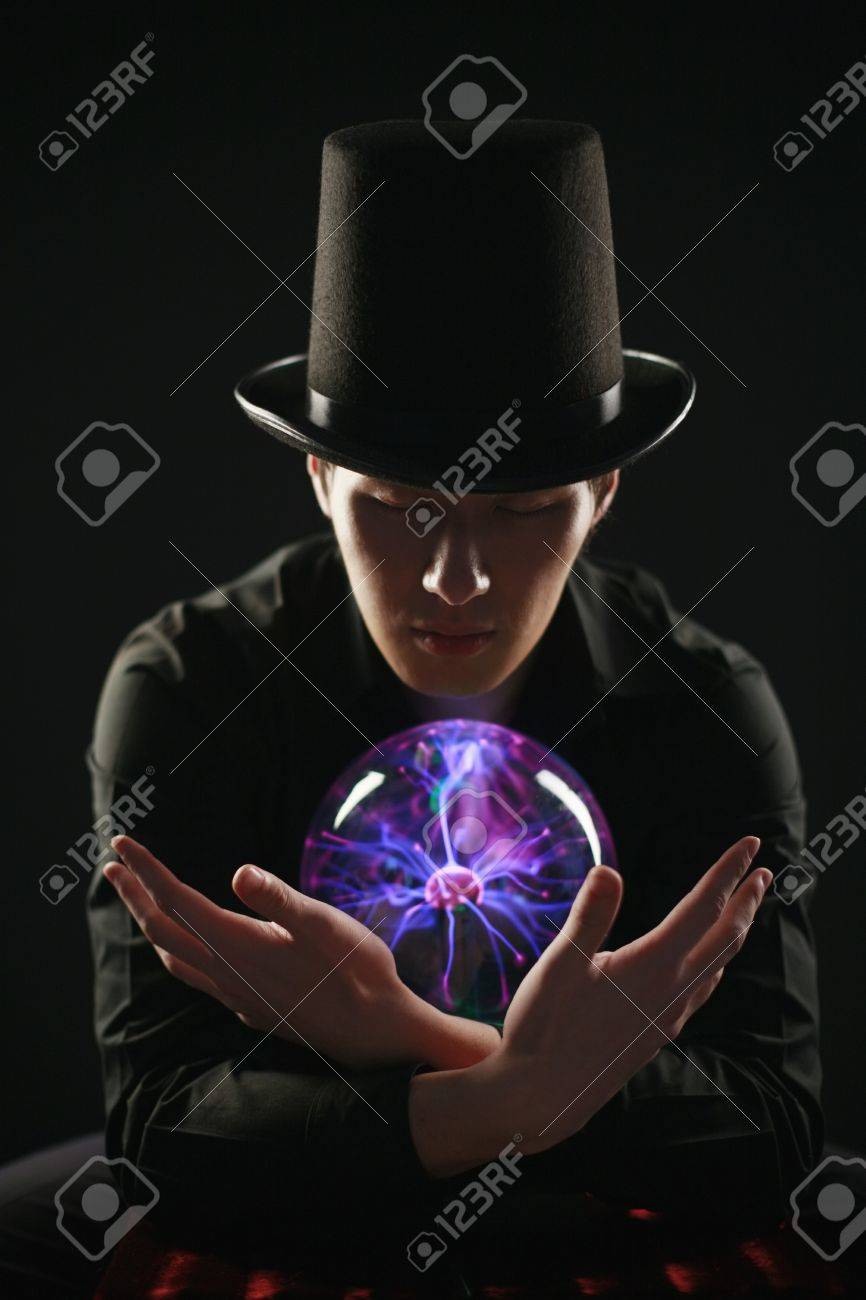 Man looking into crystal ball Stock Photo - 9287996