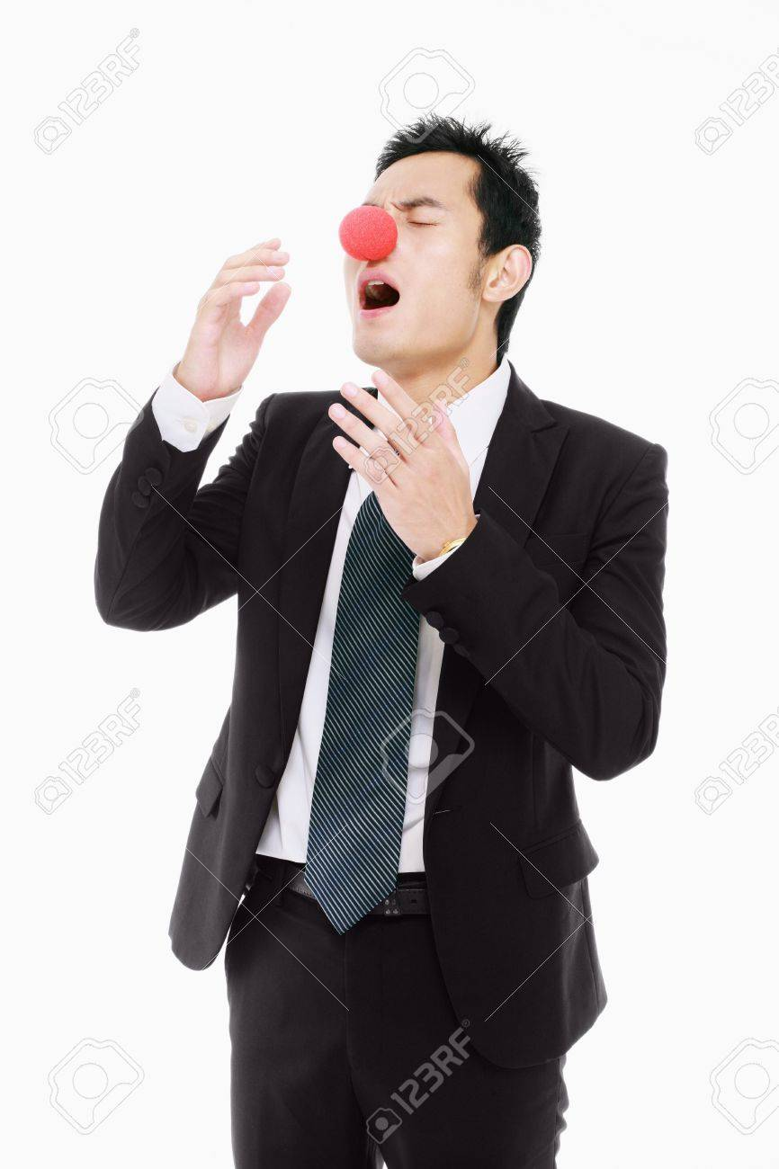 Businessman with red nose about to sneeze Stock Photo - 9520748