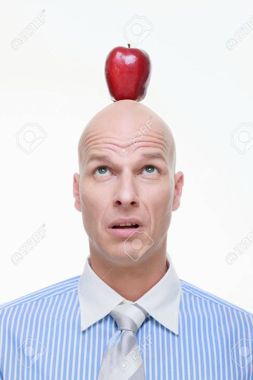 Man looking up at apple on the top of his head Stock Photo - 9525644