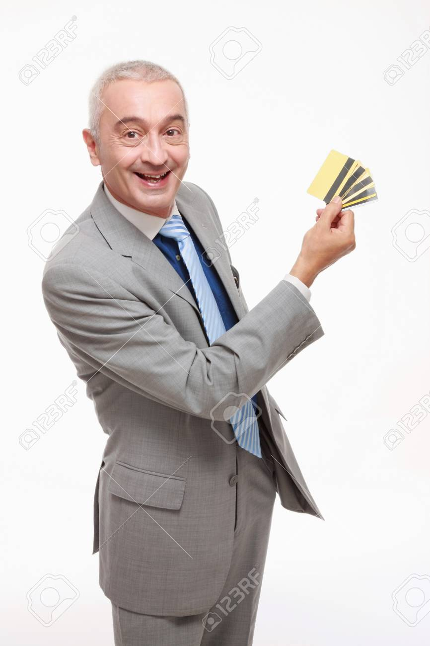 Businessman showing his credit cards Stock Photo - 9525818