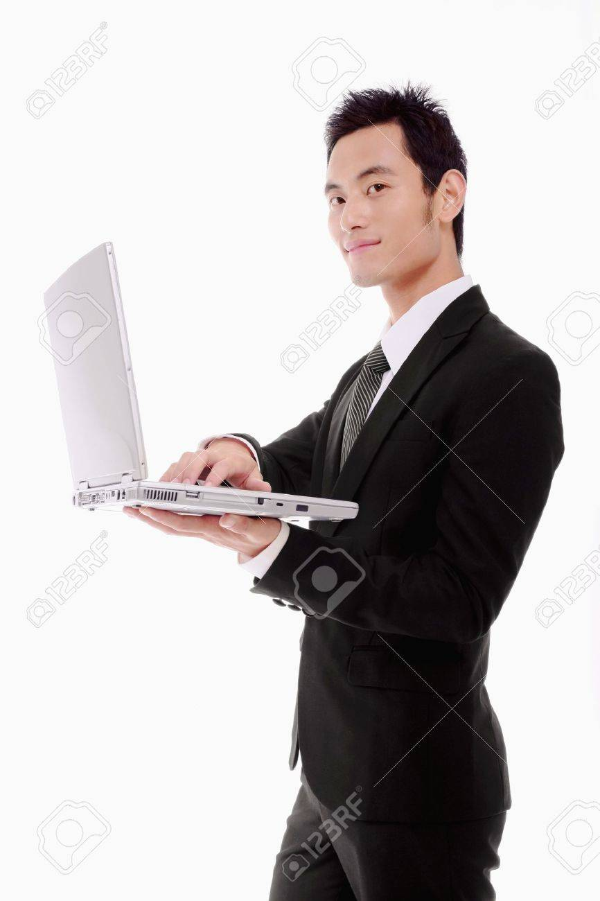 Businessman standing and using laptop Stock Photo - 9605430