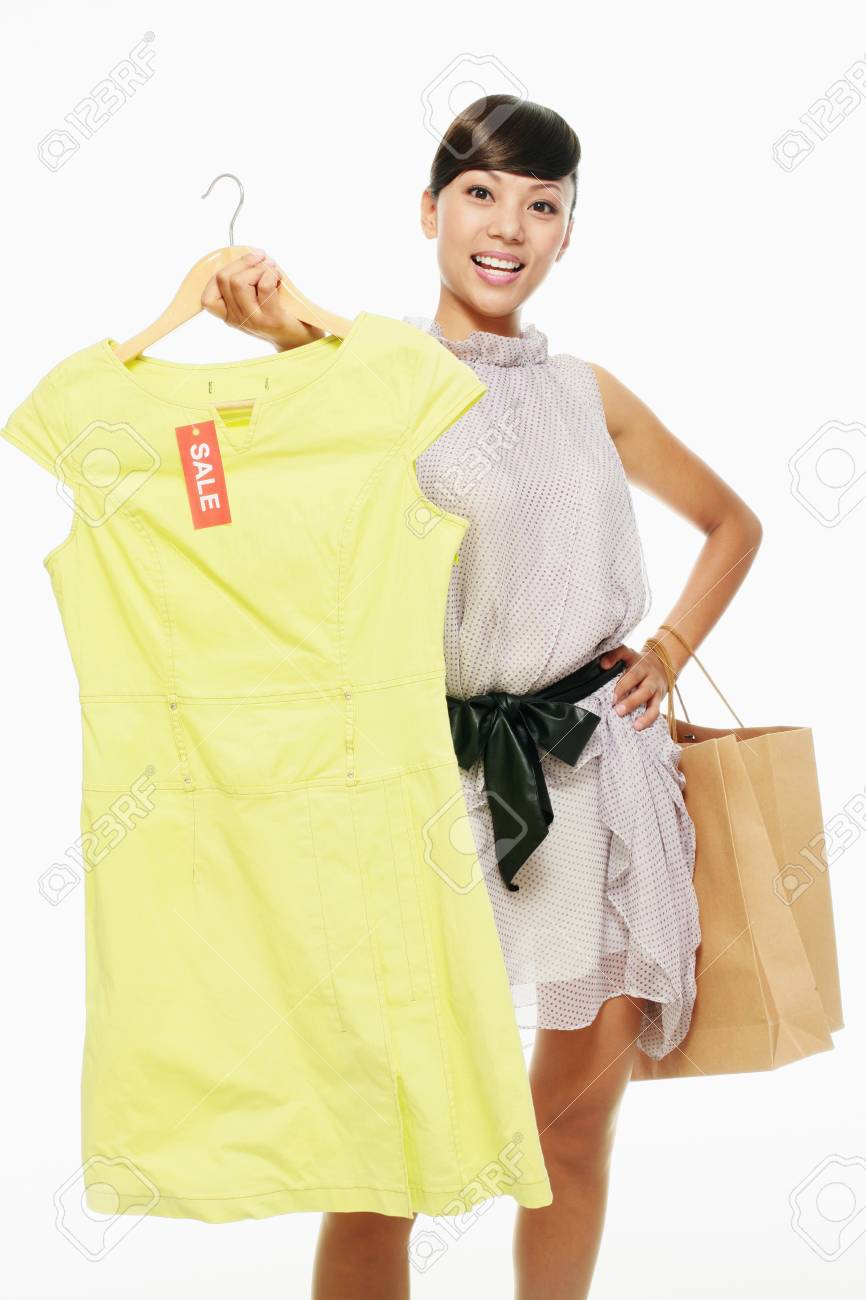 Woman holding dress on sale in front of her Stock Photo - 9604468