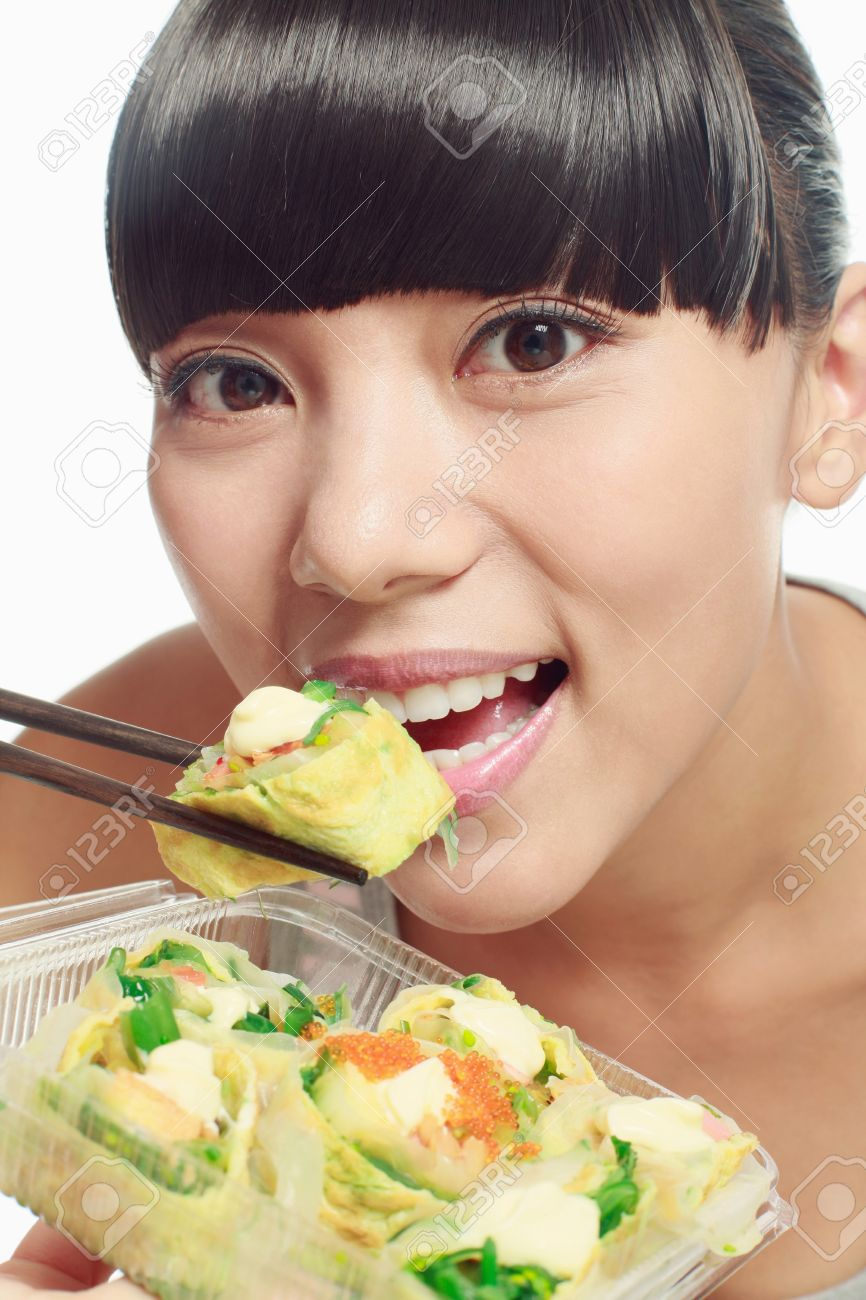 Woman eating chinese food with chopsticks Stock Photo - 9605671