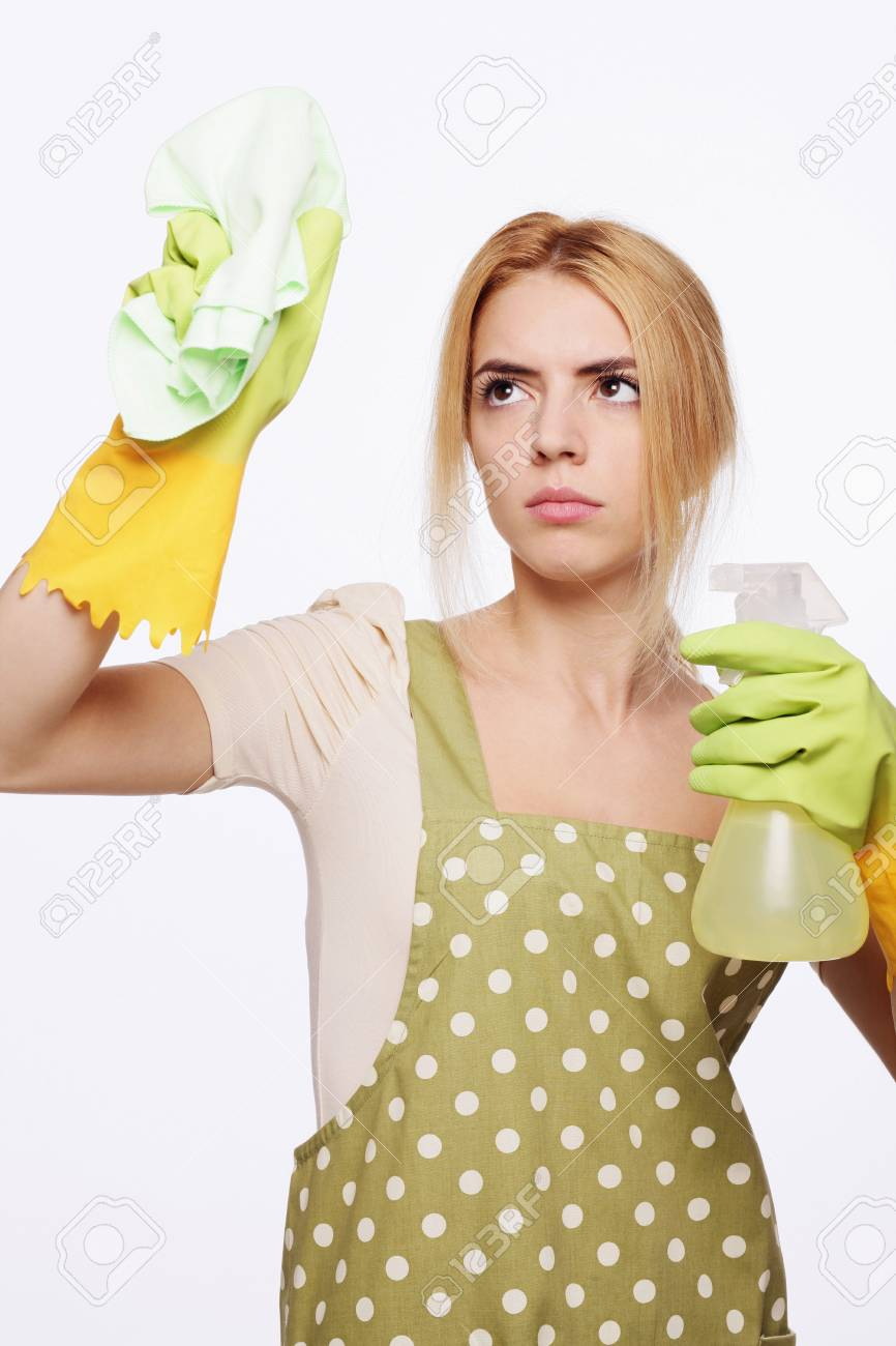 Woman spraying and wiping Stock Photo - 9605317