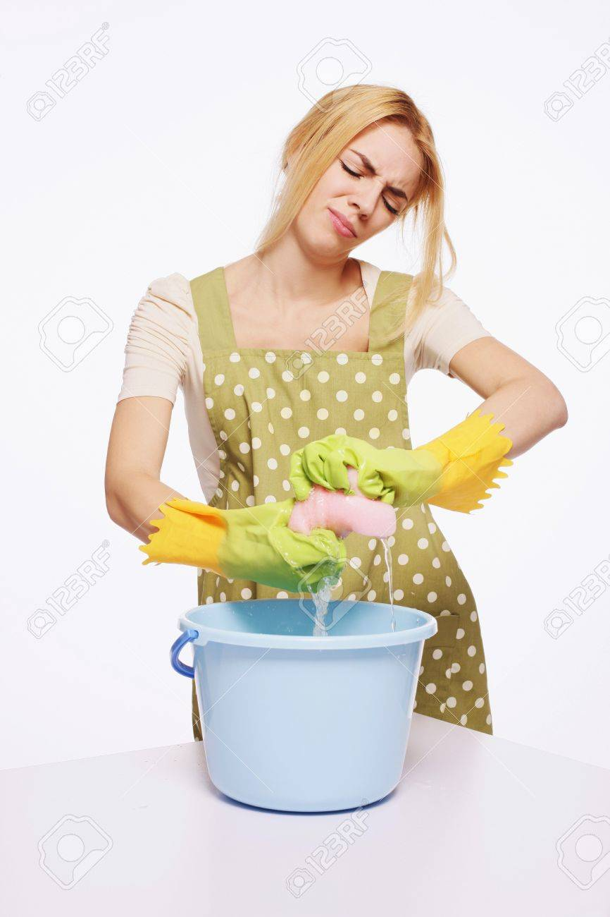 Woman squeezing water from cleaning sponge Stock Photo - 9605600