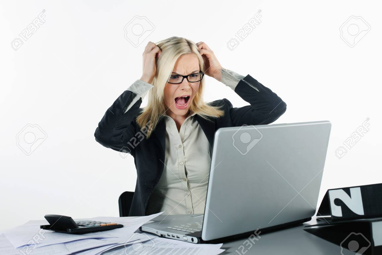 Businesswoman looking frustrated while using laptop Stock Photo - 9900856