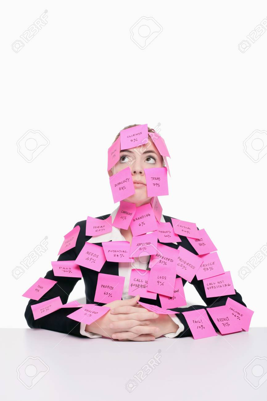 Businesswoman covered with adhesive notes looking up and thinking Stock Photo - 9956696