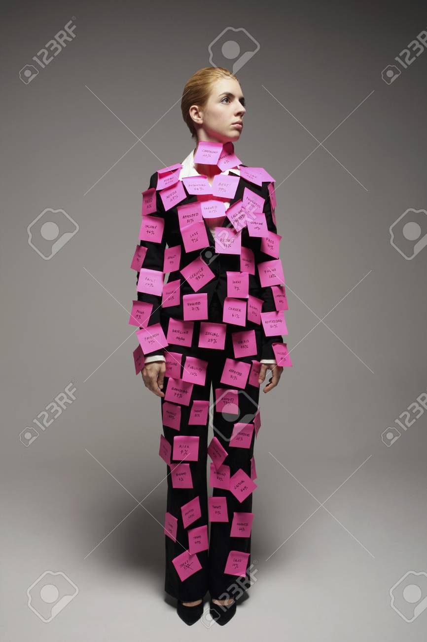 Businesswoman covered with adhesive notes looking to the side Stock Photo - 9957656