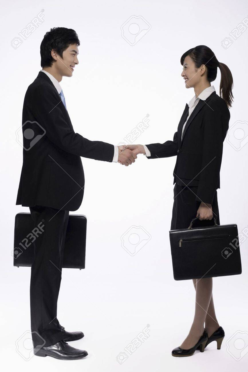 Businessman and businesswoman shaking hands Stock Photo - 9957312