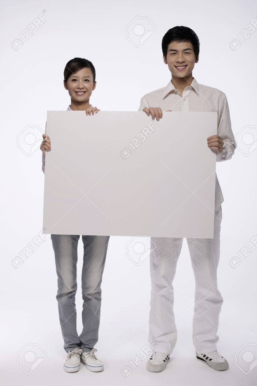 Man and woman holding white placard Stock Photo - 9957490