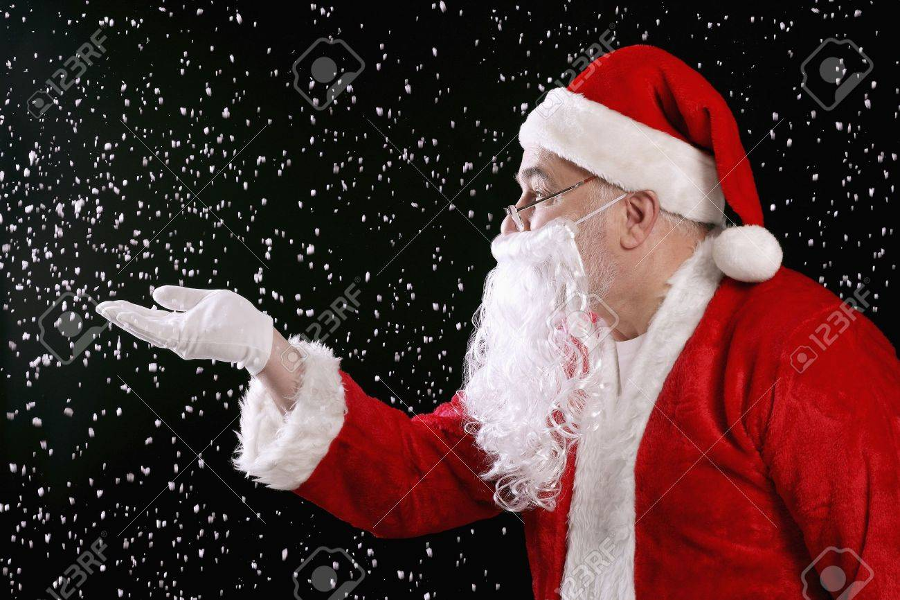 Santa claus playing with snow Stock Photo - 9957875