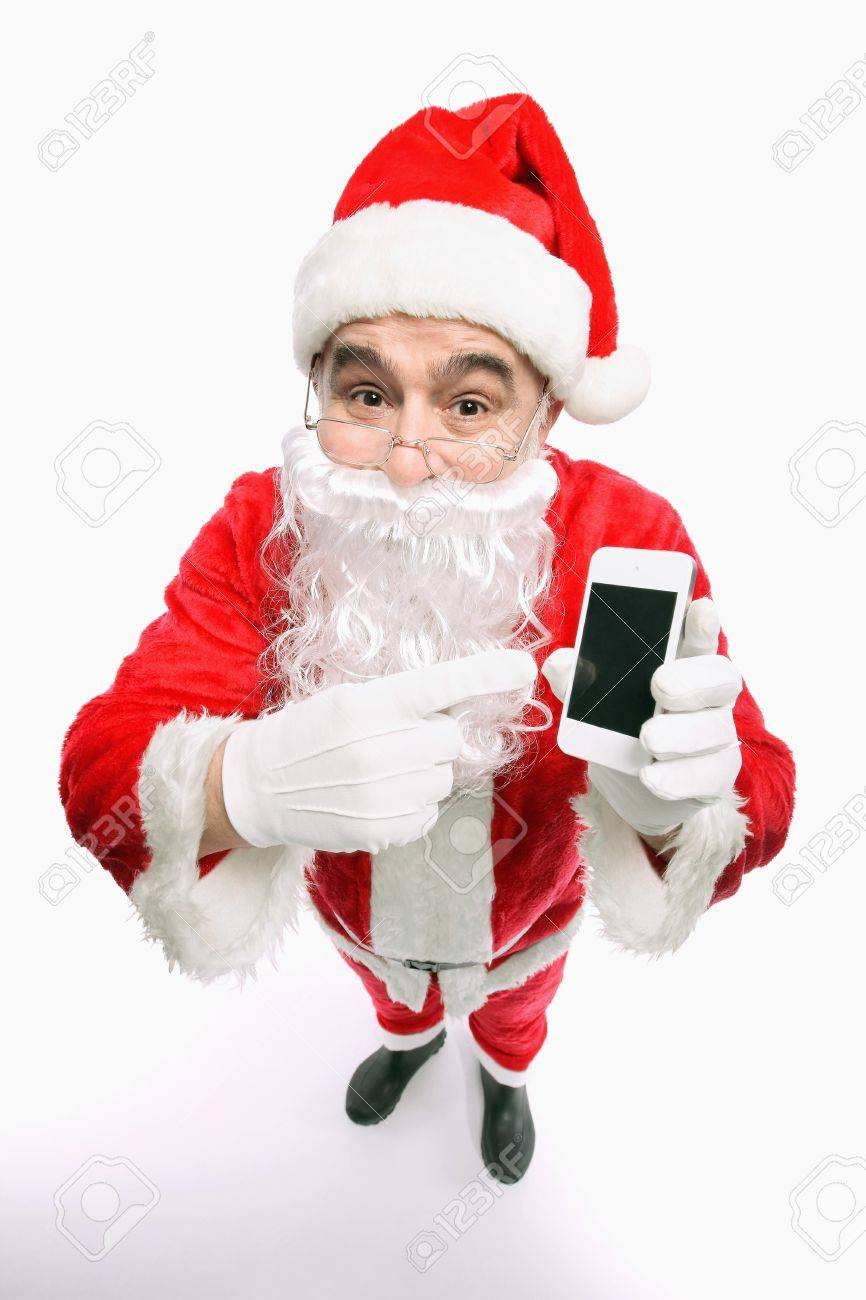 Santa claus pointing at mobile phone Stock Photo - 9956803