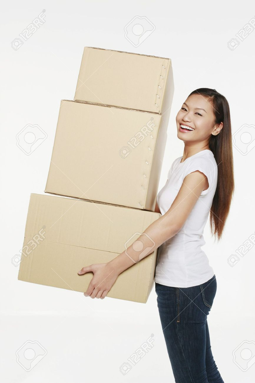 Woman carrying a stack of boxes Stock Photo - 9957492