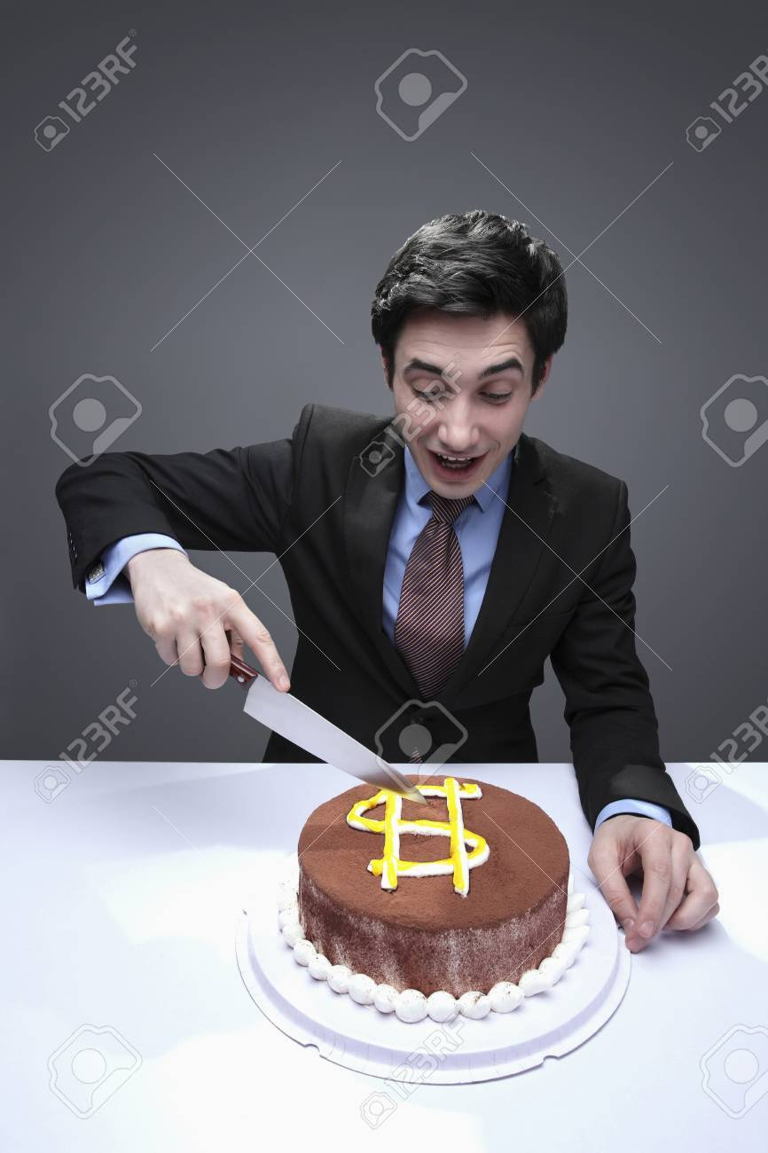 Businessman Cutting Cake Stock Photo Picture And Royalty Free Image