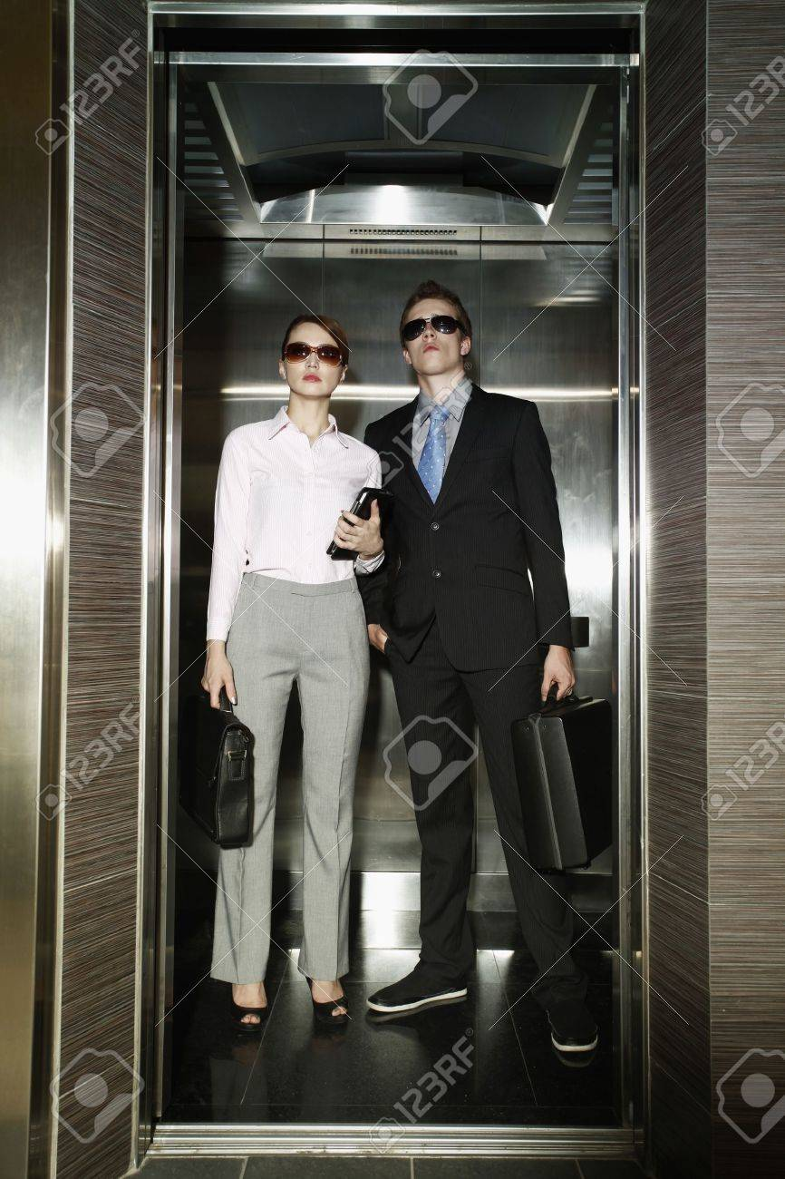 people in elevator. business people with sunglasses standing in elevator stock photo - 12515193
