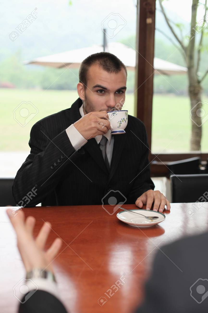 Businessman drinking a cup of tea Stock Photo - 13341547