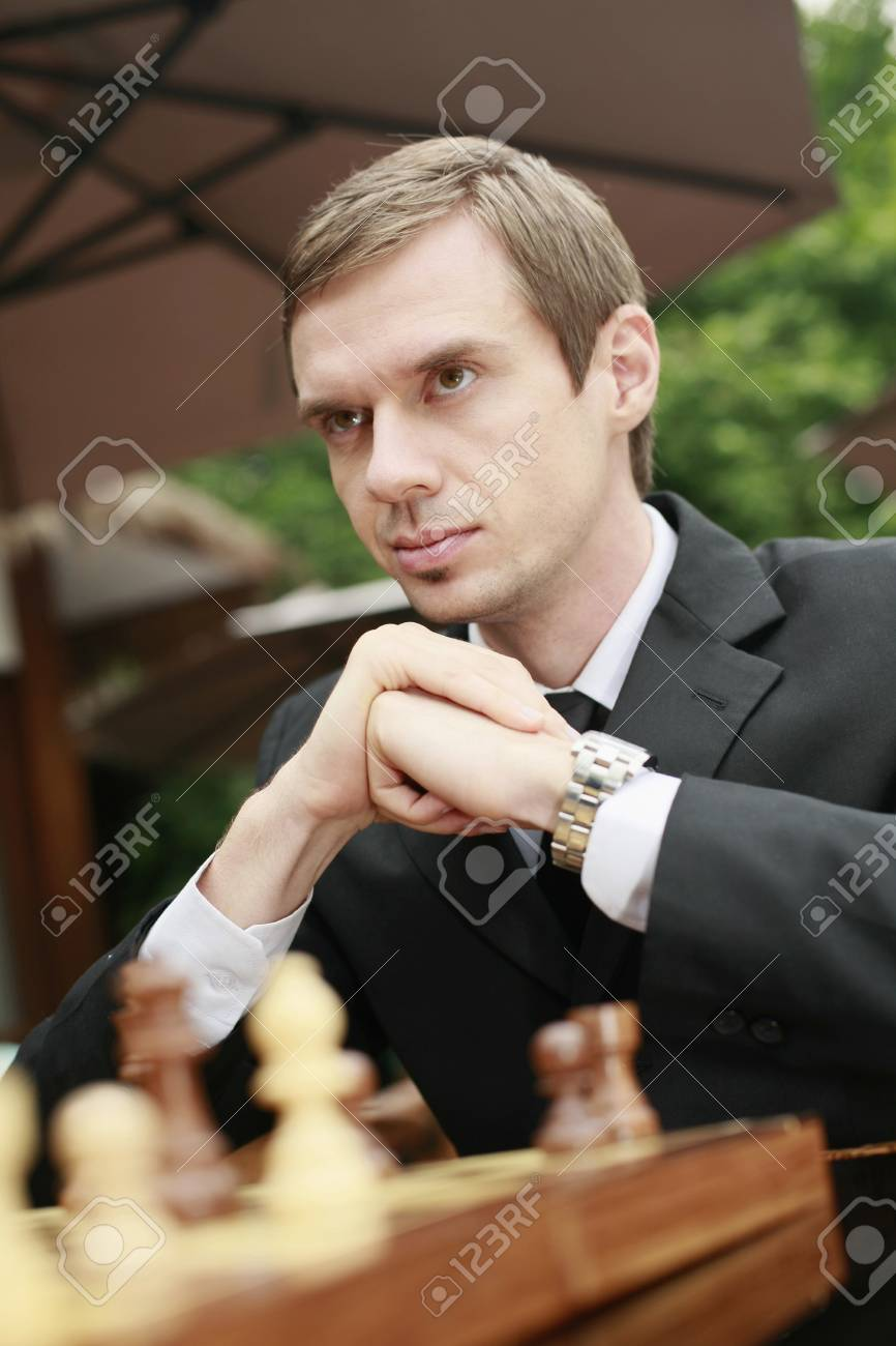 Businessmen playing chess outdoors Stock Photo - 13355160