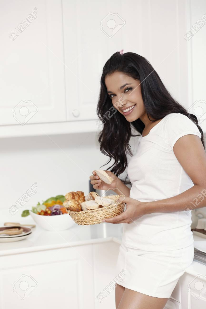 Woman eating bread Stock Photo - 13360609