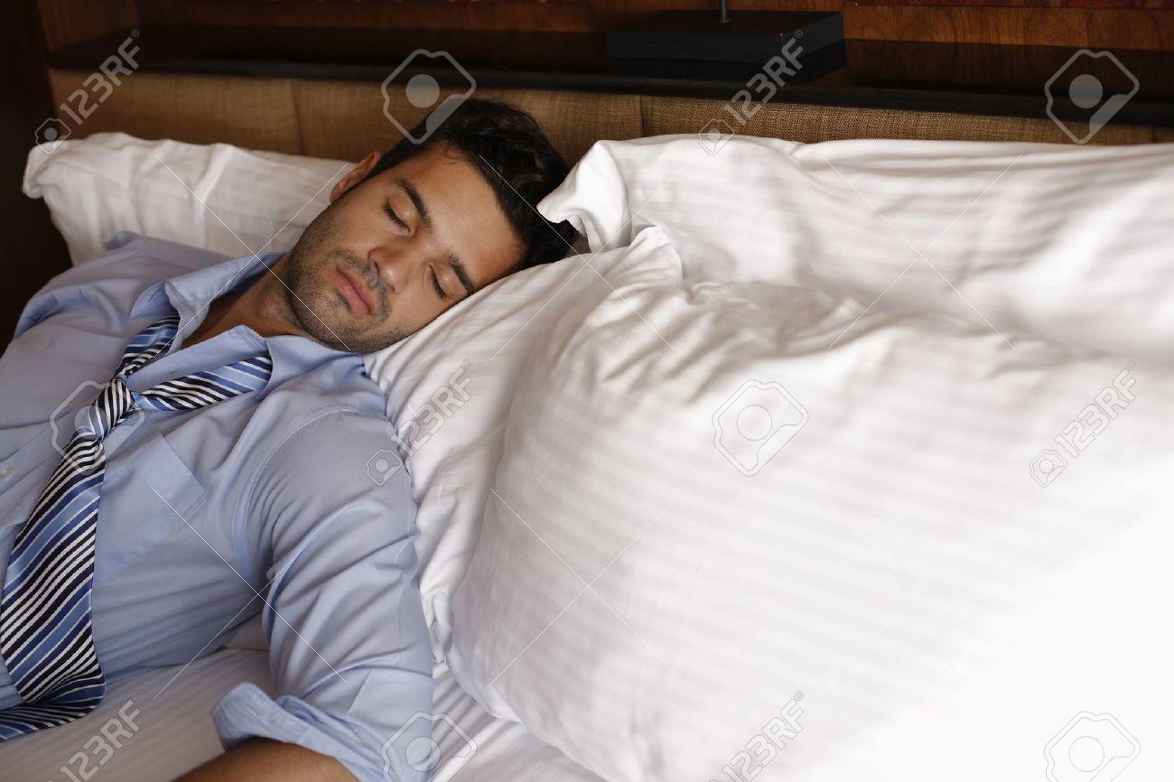 Businessman sleeping on bed - 13366850