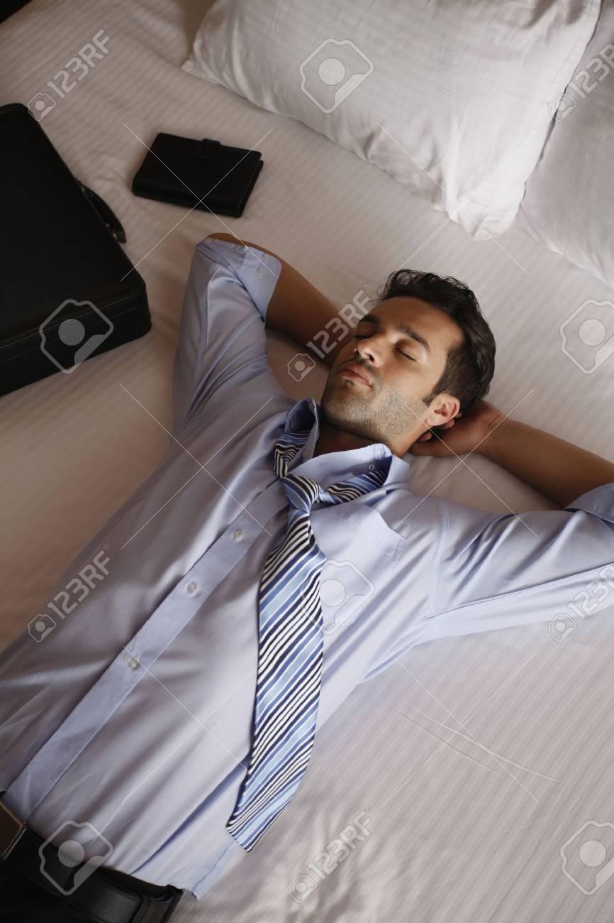 Businessman having a nap - 13366751