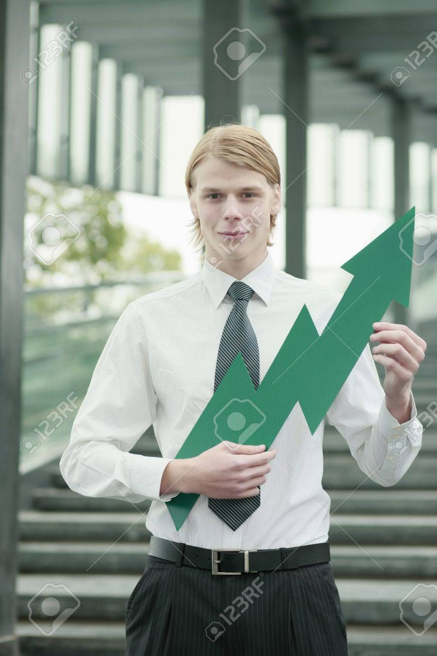 Businessman with an up pointing arrow Stock Photo - 13378390