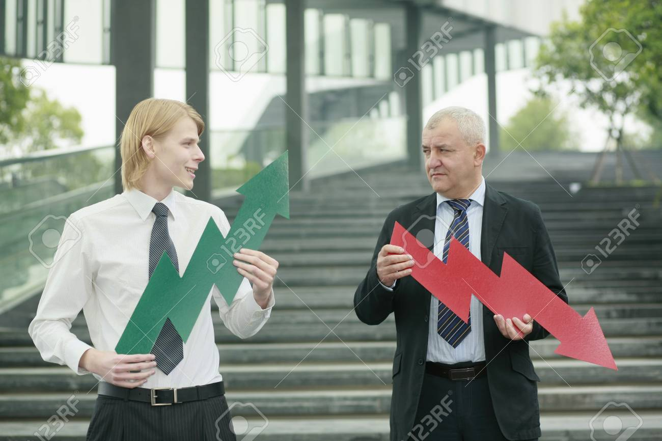 Businessmen with arrow signs Stock Photo - 13378385