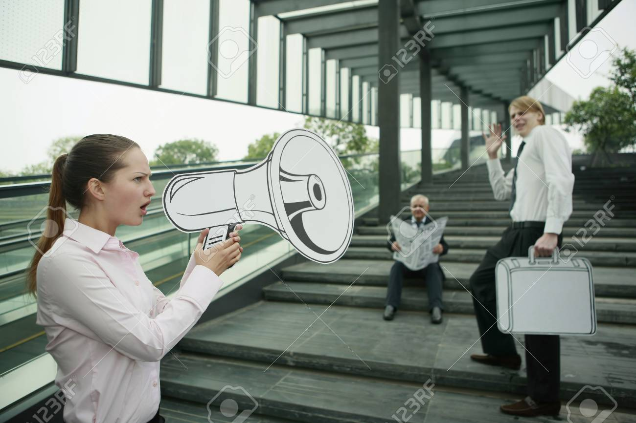 Businesswoman speaking through megaphone Stock Photo - 13377940