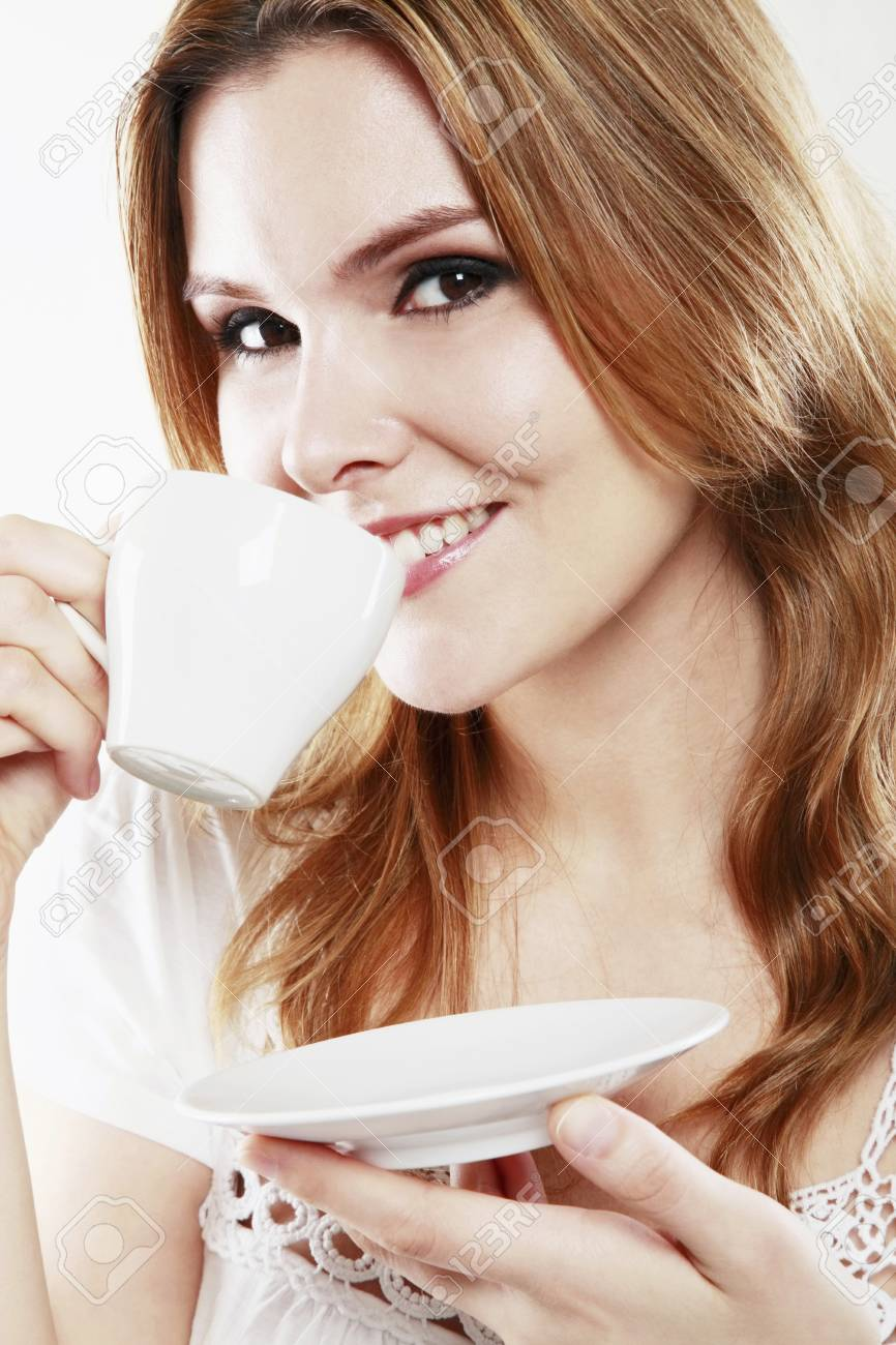 Woman enjoying a cup of coffee Stock Photo - 13384214