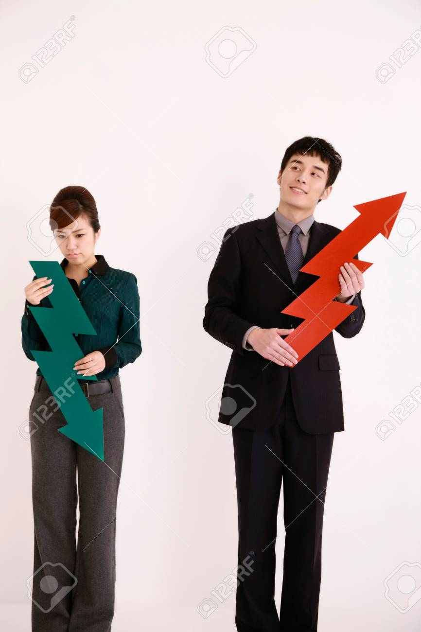 Business people holding arrow signs Stock Photo - 13384023