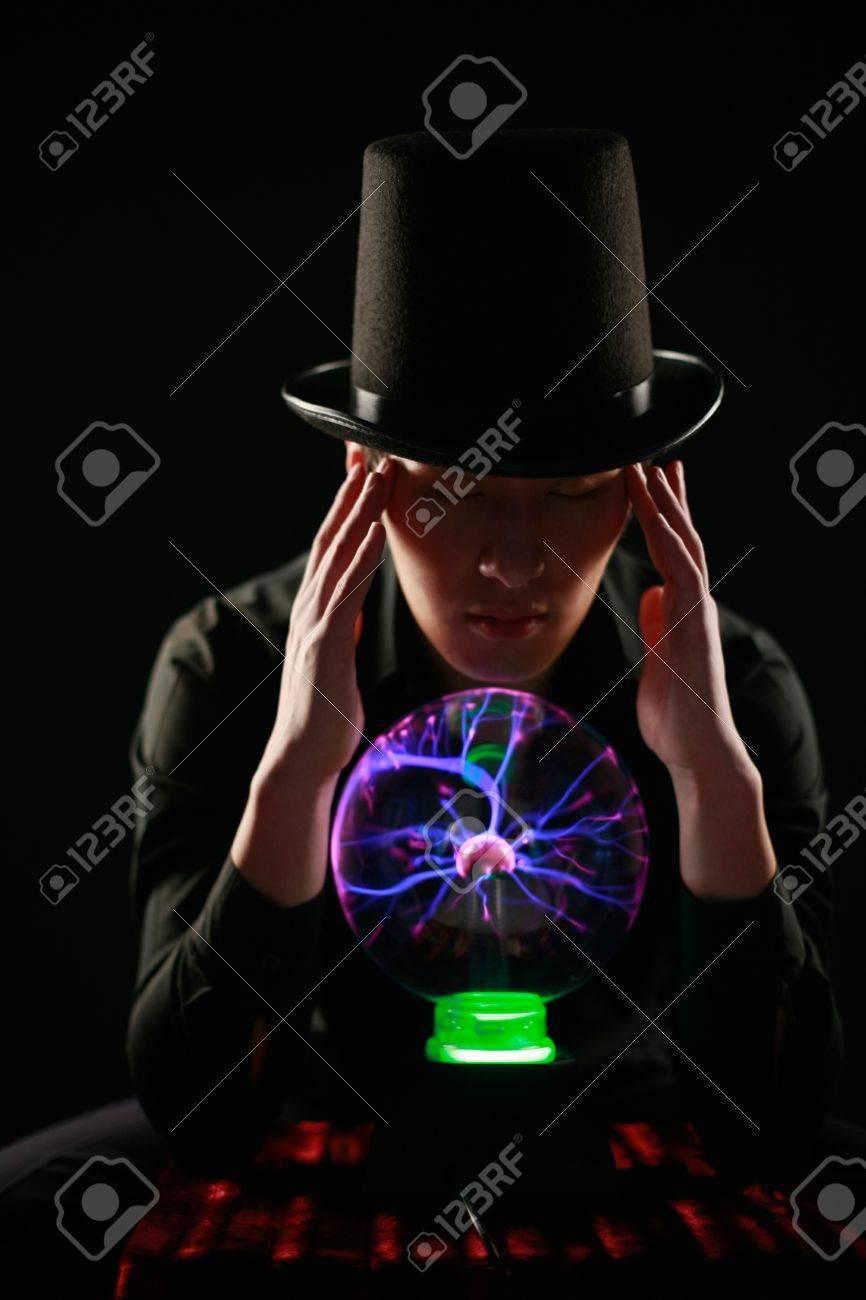 Man looking into crystal ball Stock Photo - 13383989