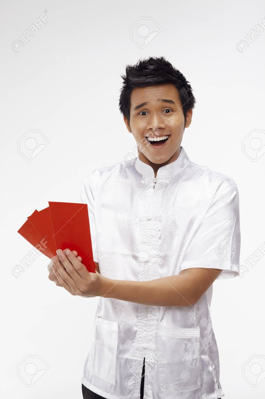 Man holding out red packets Stock Photo - 17130012