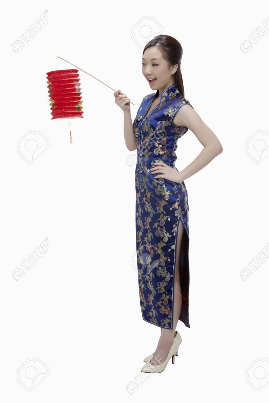 Woman in cheongsam holding paper lantern Stock Photo - 17255621