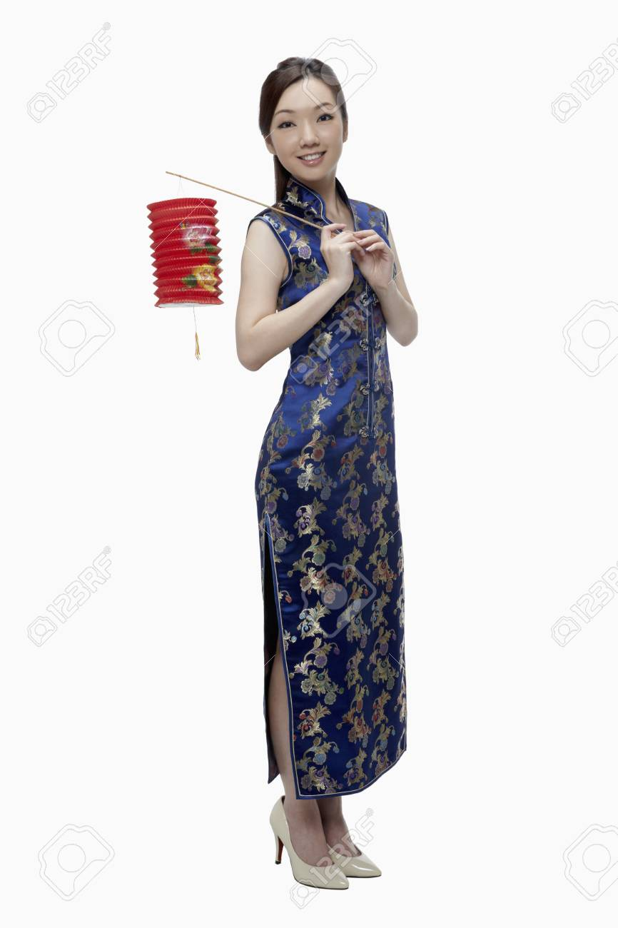 Woman in cheongsam holding paper lantern Stock Photo - 17255628