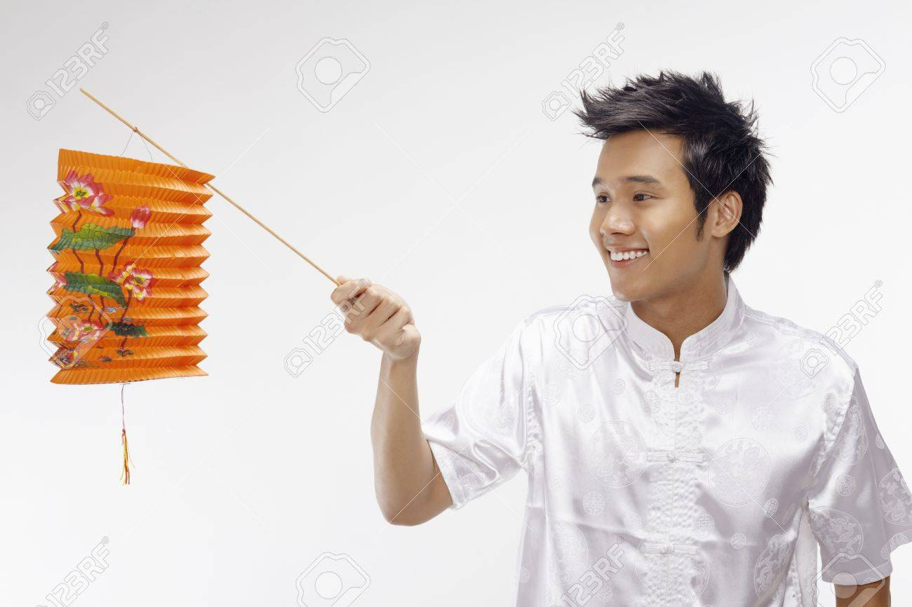 Man in traditional clothing holding paper lantern Stock Photo - 17340270