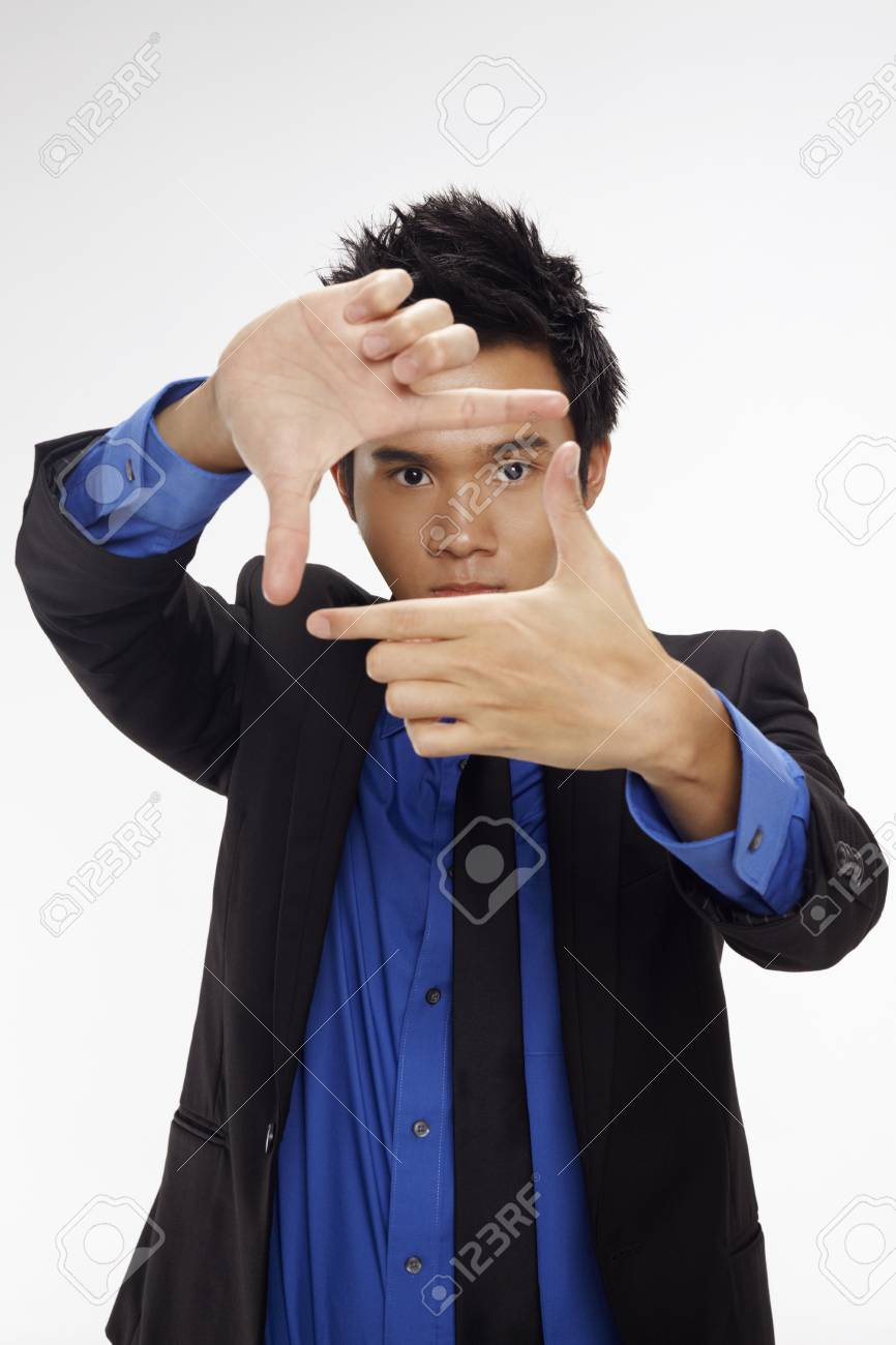 Businessman making a box frame with his fingers Stock Photo - 17340300