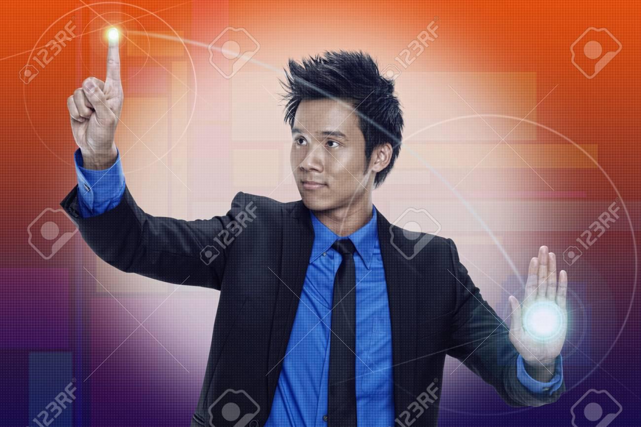 Businessman using digital screen Stock Photo - 17340318