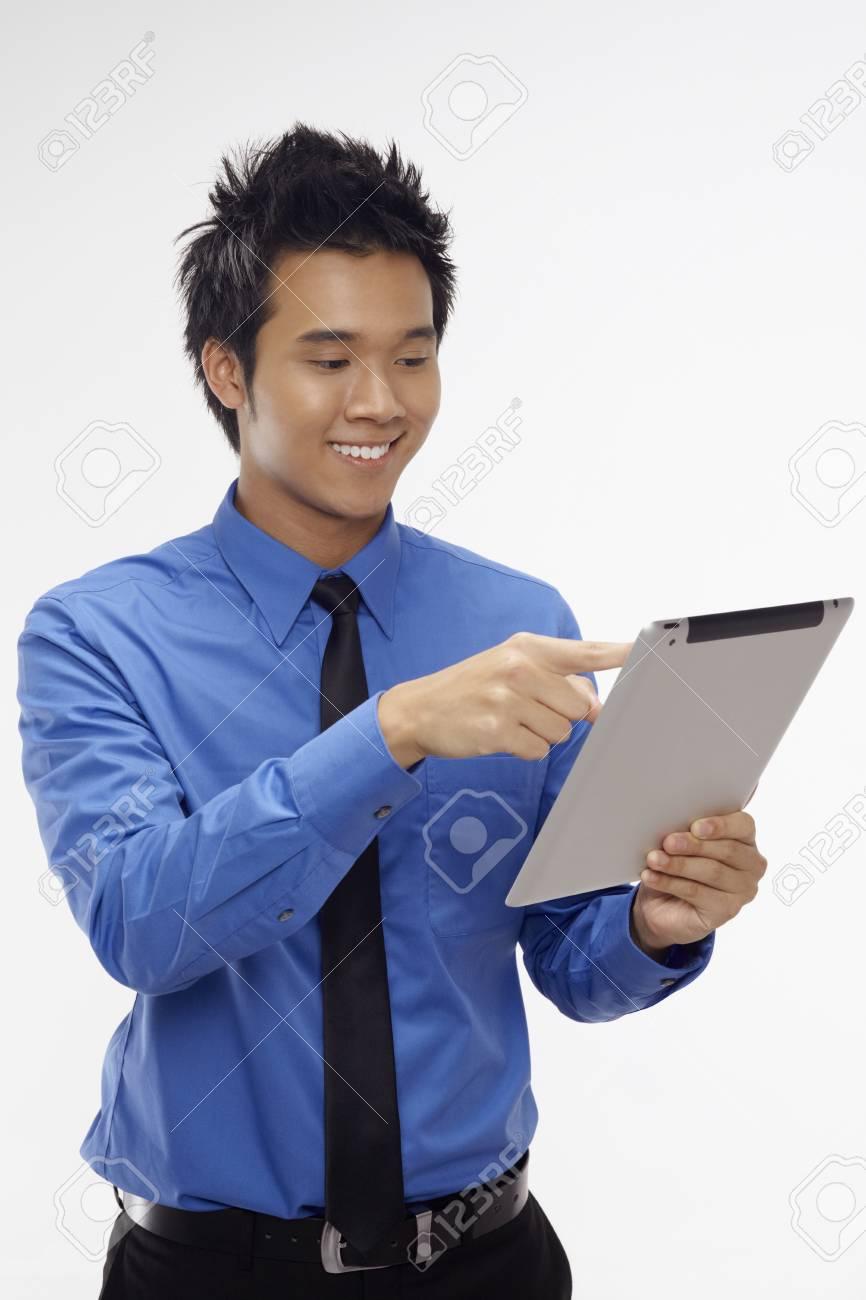 Businessman using digital tablet Stock Photo - 17340283
