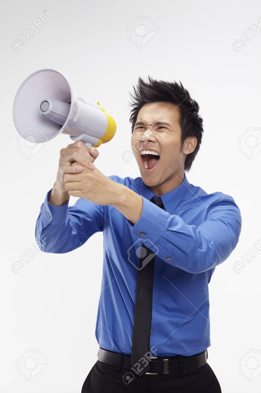 Businessman screaming into megaphone Stock Photo - 17340277