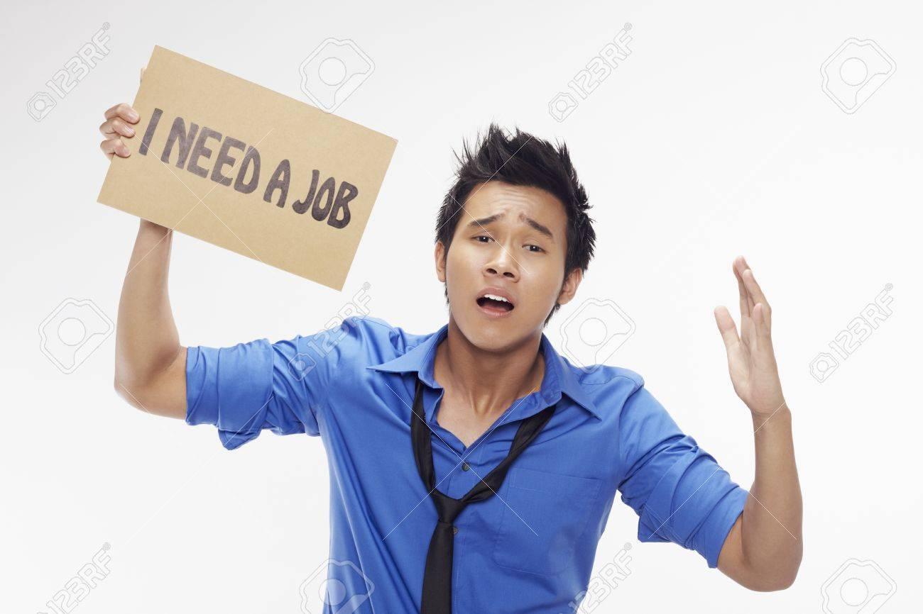 Businessman holding  I need a job  sign Stock Photo - 17340257