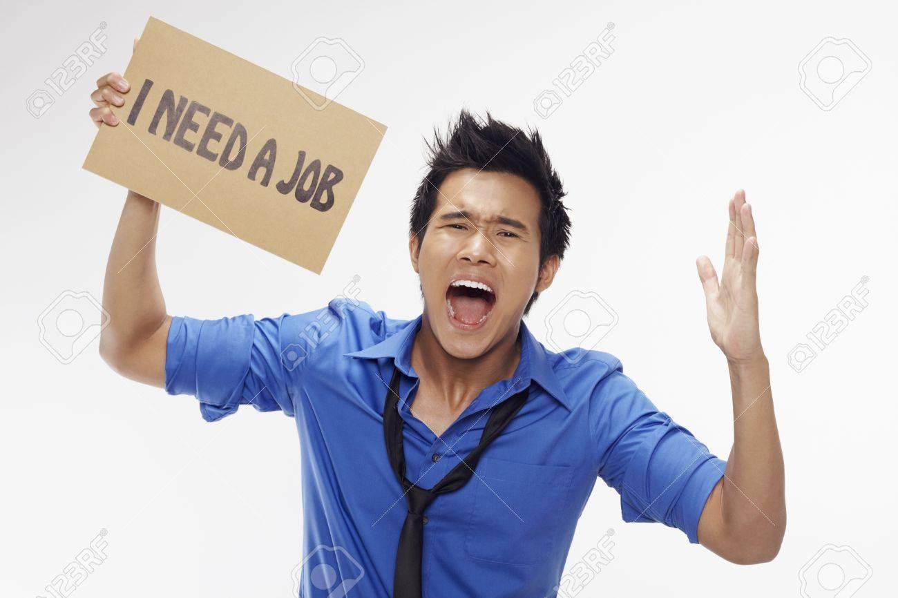 Businessman holding  I need a job  sign Stock Photo - 17340272