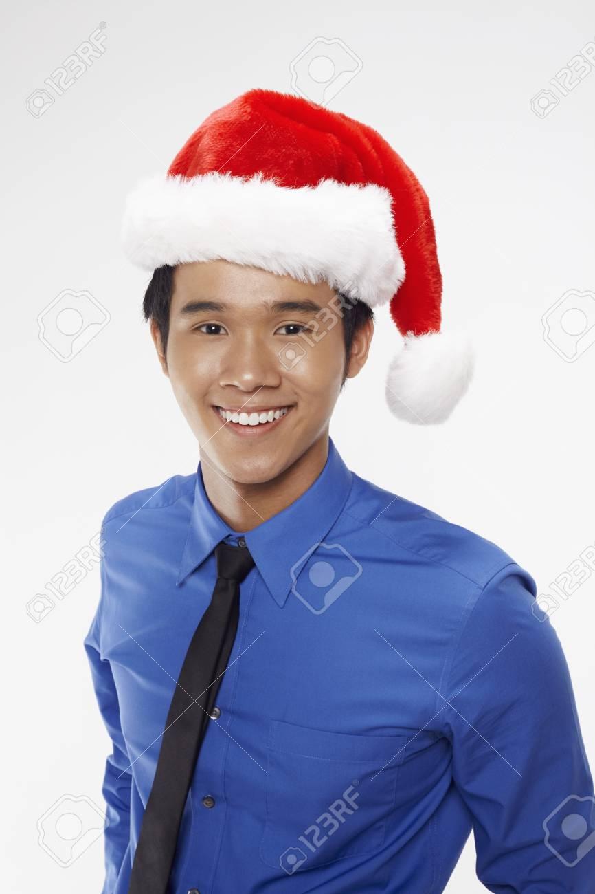 Businessman wearing Santa hat Stock Photo - 17340306