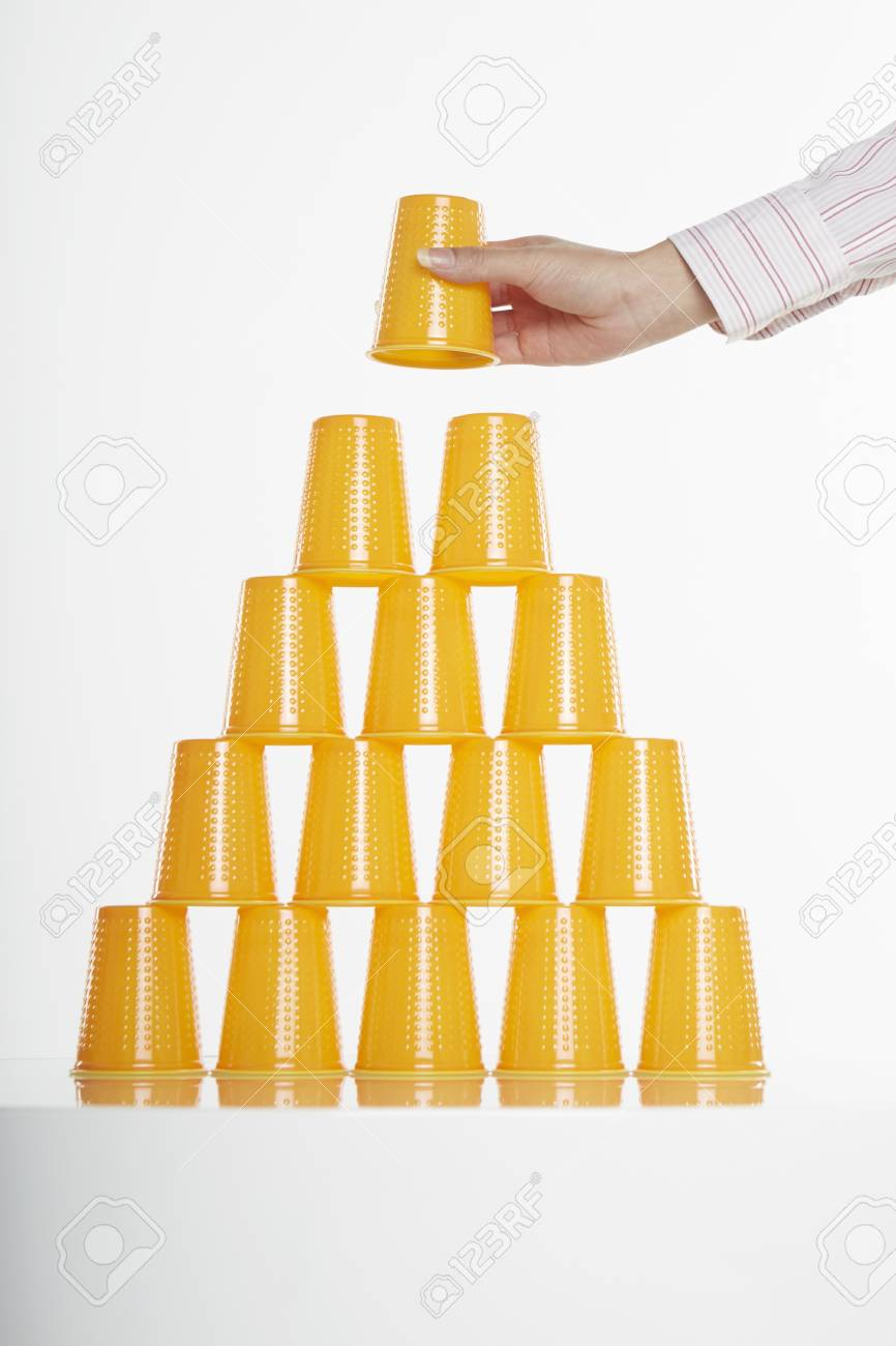 Hand placing disposable cup on top of stack Stock Photo - 19284979