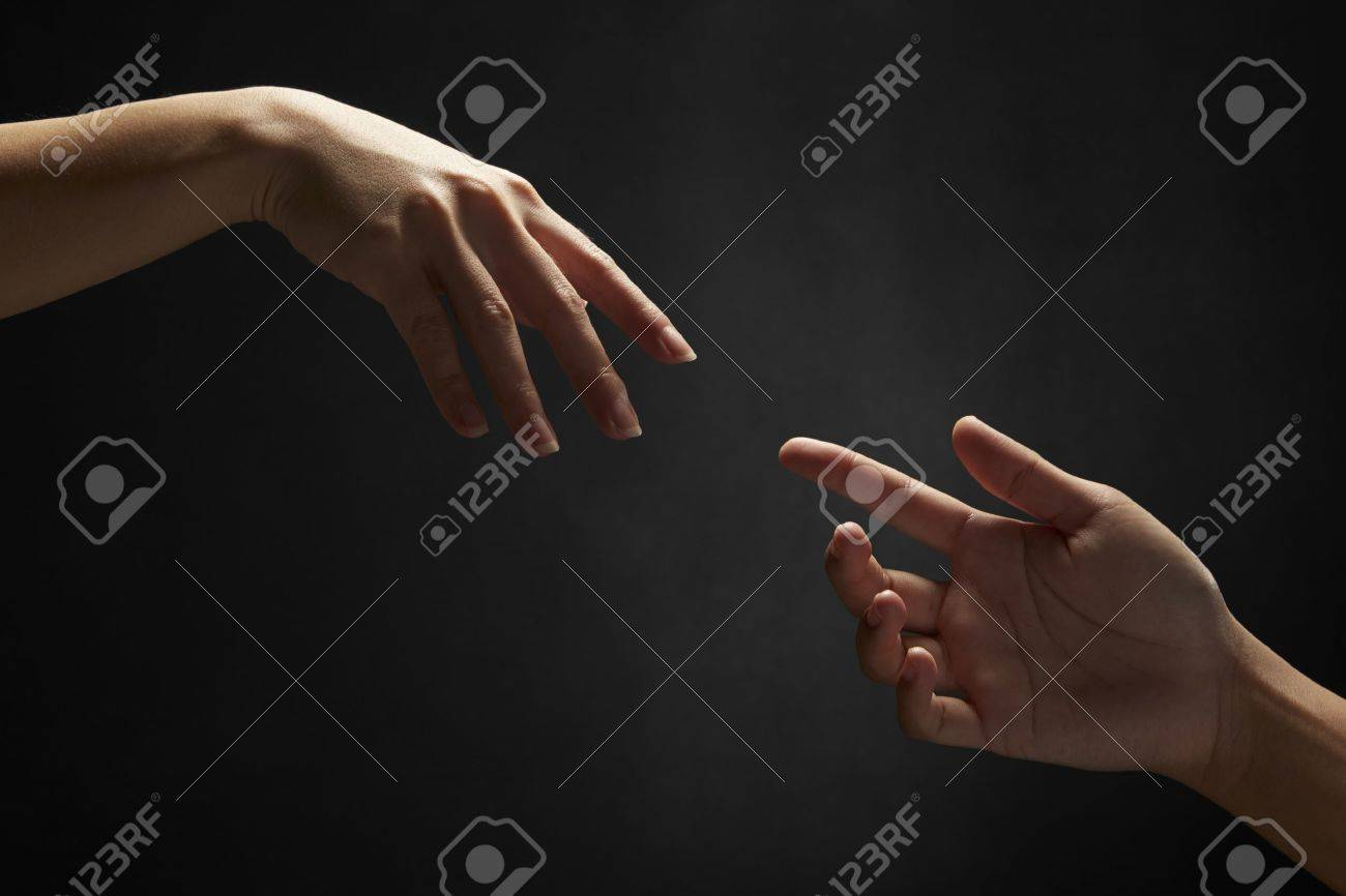 Hands reaching out to one another - 20447635