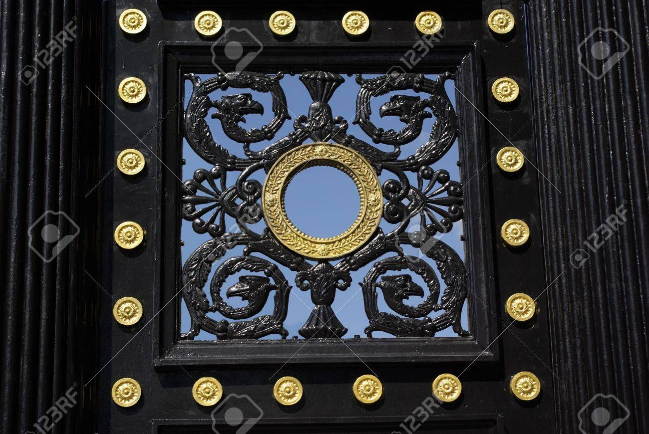 Pig-iron lattice of an old gate. Images of a gate. On a background of the sky Stock Photo - 3263965