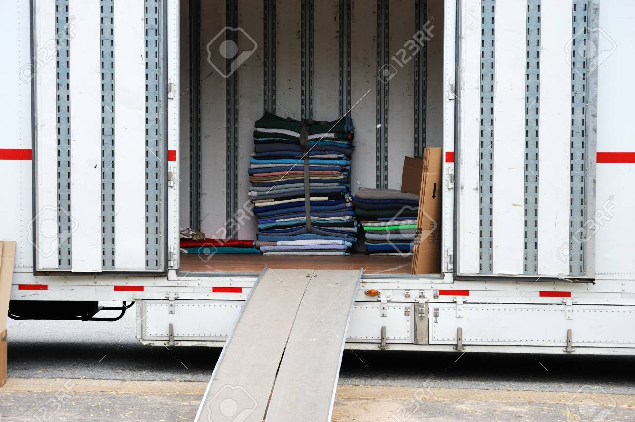Home Moving Truck And Stacking Furniture Pads Stock Photo   66188389
