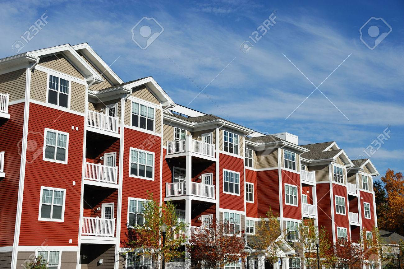 Close up on modern apartment building with blue sky - 68498144