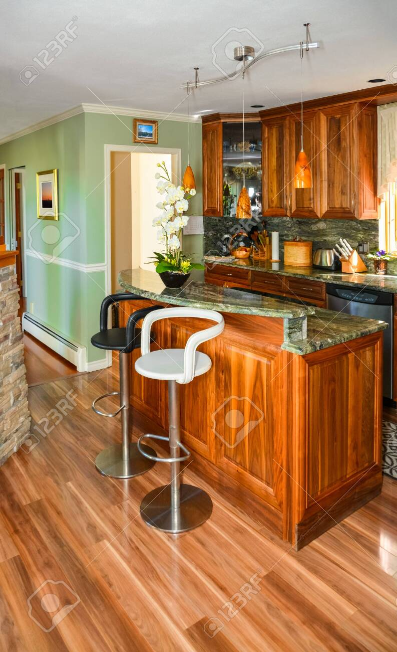 Stylish Kitchen Wooden Interior With Island Table And Two Chairs Stock Photo Picture And Royalty Free Image Image 133170591